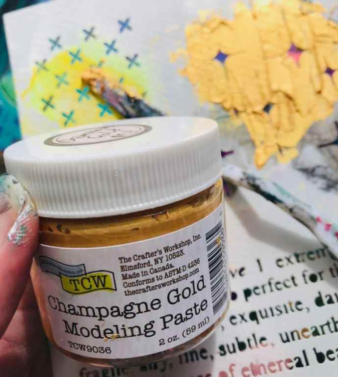 adding gold stars with modeling paste