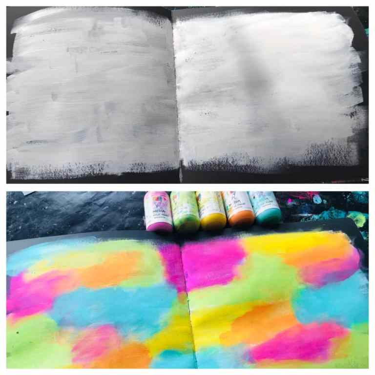 black art journal page with white gesso added and then lollipop colors