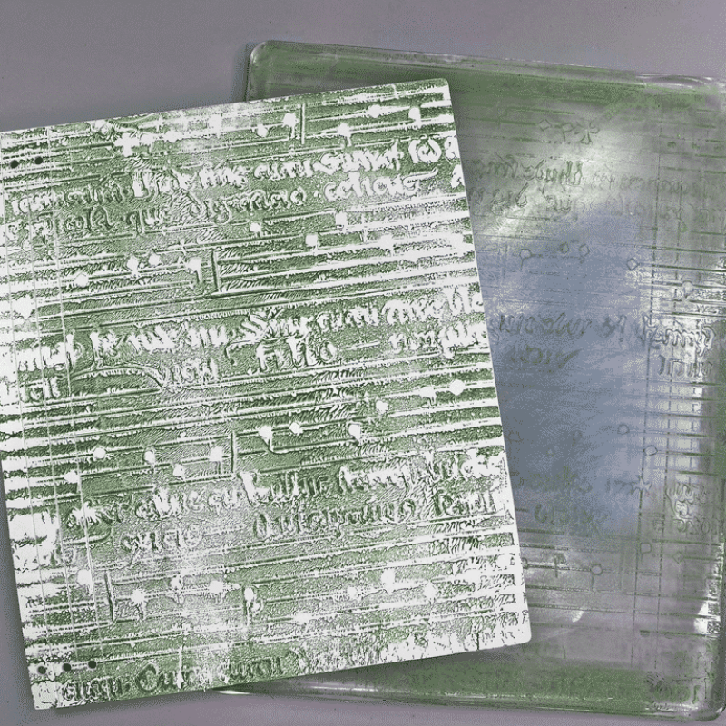 Hero shot. Two images showing the outside covers of the handmade journal. On the left is Artful Thoughts and Theories, on the right is Breath Notes.
