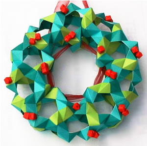 The Christmas Origami Wreath is 2 shades of green with little red berries