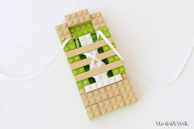 Practice tying up your shoelaces with this simple Lego practice board