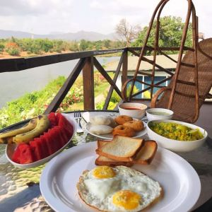 Breakfast from tha balcony of the Birds Nest Chalet, Anchaviyo Resort.