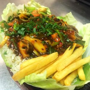 Chinese Sizzler : Exotic veggies in a black bean sauce with fried rice + noodles and fries.