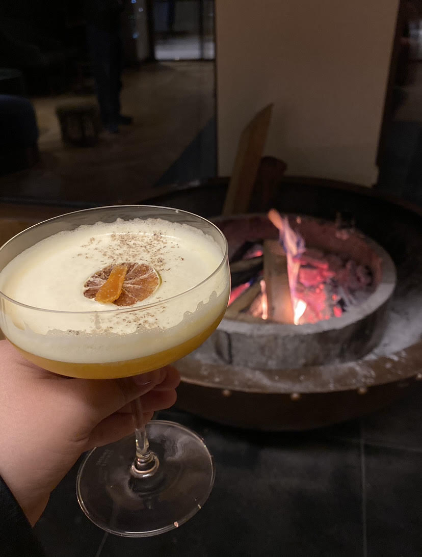 Cocktails by the fireplace.