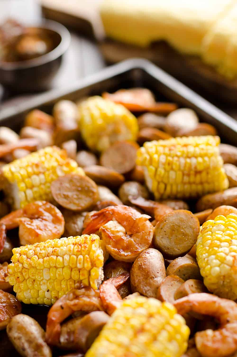 BBQ Shrimp & Sausage Sheet Pan Dinner is an easy and wholesome recipe perfect for a weeknight family dinner. Roasted sweet corn and potatoes are paired with BBQ shrimp and Gold'n Plump Hickory Smoked Sliced Chicken Sausage for a comforting low-fat meal!