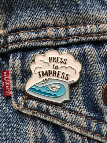 Press to impress enamel pin