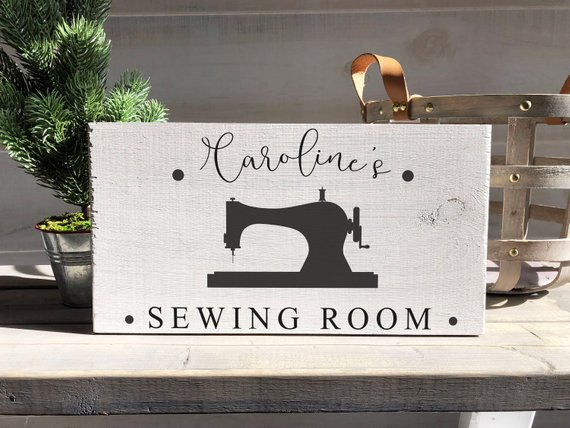 Wooden sewing room sign