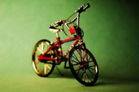 11628212-a-children-bicycle-on-a-green-background