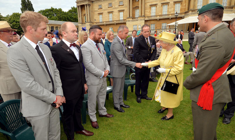 The Queen begins the round of this year's garden parties at the Palace. (John Stillwell/WPA Rota/Nunn Syndication/Polaris)