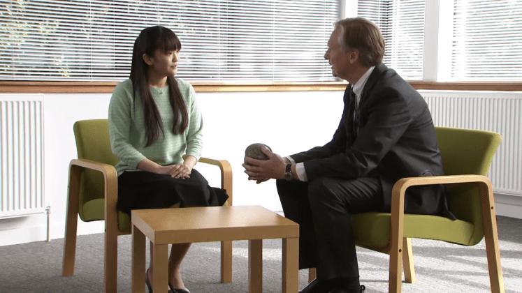 Mako talks to a professor at university. (Still from Universtiy of Leicester's video)