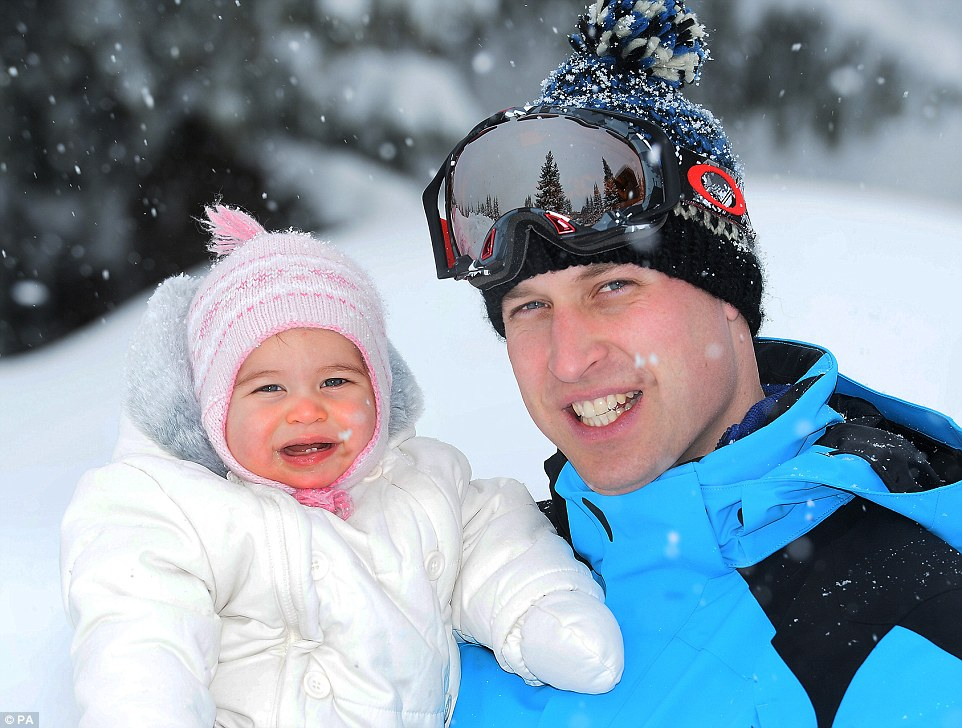Prince William holds daughter Charlotte in a photo by John Stillwell/PA
