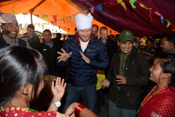 Harry is welcomed by locals in Nepal. I-images