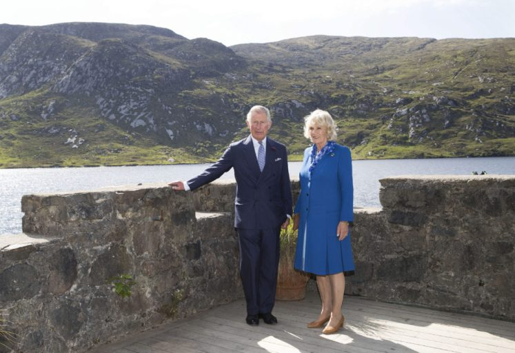 The Prince of Wales and Duchess of Cornwall admire the views of a loch from the grounds of Glenveagh Castle in Ireland. Picture by Stephen Lock / i-Images