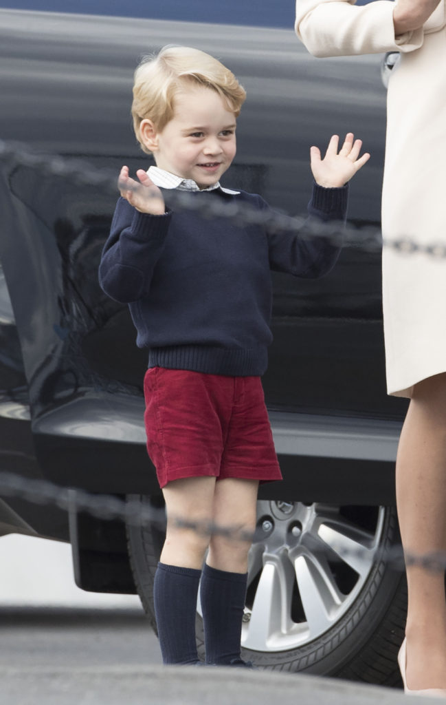 Prince George waves to the crowds as he boards a seaplane with his parents and sister. Picture by Stephen Lock / i-Images