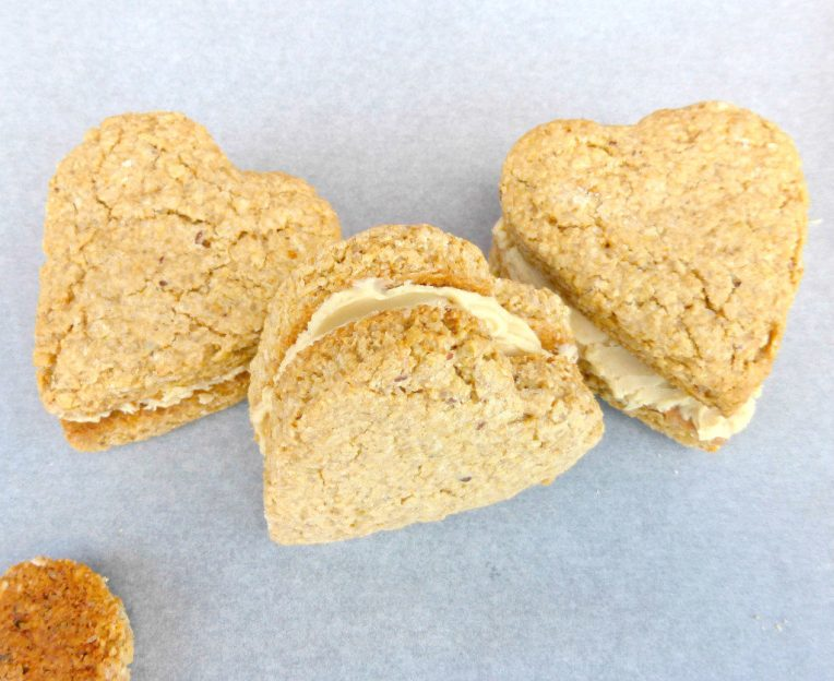 Oatmeal Cookie Sandwiches with a Peanut Butter and White Chocolate Filling