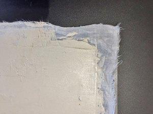 Tile cement spread onto wet cotton fabric