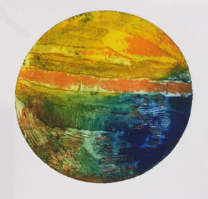 A colourful print from a circular shaped printing plate