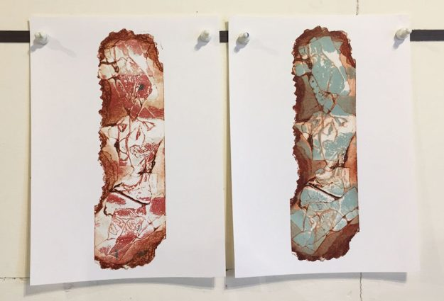 two prints from a torn printing plate