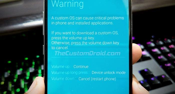 Нажмите и удерживайте кнопку увеличения громкости, чтобы войти в режим разблокировки устройства на Galaxy Note 10/10 +