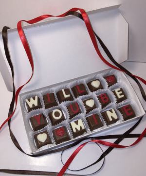 """?zoom Description WILL YOU BE MINE!!! PERSONALIZED CHOCOLATE GIFT BOX!!! Thank you for stopping by Sweet Kicks Candies! We take pride in making your taste buds tingle with our homemade treats. There are a lot of Baked goods and candies out there but nothing compares to the flavors of Sweet Kicks Candies. We are a family owned business, and we take pride in offering quality products and excellent customer service. Make sure you check out all of our flavors and favorite our shop so that all can enjoy these amazing treats!! Custom made chocolate box!!! Perfect unique gift!! Made fresh to order!! 18 chocolates measureing approximately 1x1 Each chocolate box is custom made. A proof of your box will be sent via etsy conversation prior to shipping for approval. When ordering: 1. Specify in notes """"to seller"""" what you would like your custom chocolate to say. ( 18 letters) 2. Choose your color from the colors listed and specify in notes. 3. Choose white or milk chocolate. 4. Ask any questions prior to ordering. Please contact us with any questions. If temperature in your location is above 65 degrees please choose the option for the hot weather shipping from the drop down menu and your items will shipped accordingly with ice packs. Not responsible for melting if appropriate shipping is not chosen. Please allow 3-5 Business days to prepare your order fresh before it is shipped. Priority Mail Only!!! Shipping with the United States Only + More Reviews 5 out of 5 stars (129) Reviewed by Jana Vidrine 5 out of 5 stars 02 Feb, 2018 Personalized Chocolates Gift Box, ! White Chocolate Gift Box, Milk Chocolate Gift Box, Men Gift, Women Gift, Customize for your Occasion Reviewed by Jenna Tregaskis 5 out of 5 stars 29 Aug, 2017 Better than expected!! Wrapped SUPER TIGHT, there's no chance they would melt with that ice pack!!! Just lovely! Very happy! Personalized Chocolates Gift Box, ! White Chocolate Gift Box, Milk Chocolate Gift Box, Men Gift, Women Gift, Customize for your Occasion Re"""