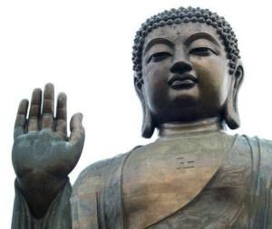 a budda statue showing the varada mudra