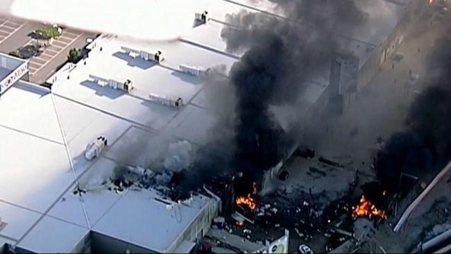 Plane crashes into shopping centre near Melbourne