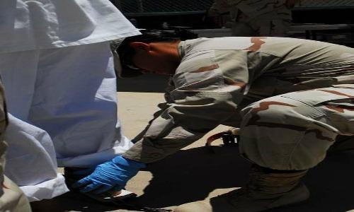 427px-Shackle_adjustment,_Guantanamo_-a