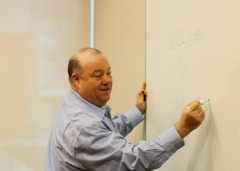 David Cohen writing on a white board