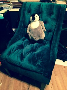 The penguin rocks the peacock chair.