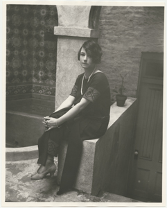 Dorothy Parker in backyard of residence at 412 West 47th Street, New York City