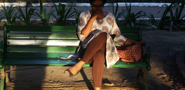 City Moment – Woman Reading a New Novel, Lodhi Garden