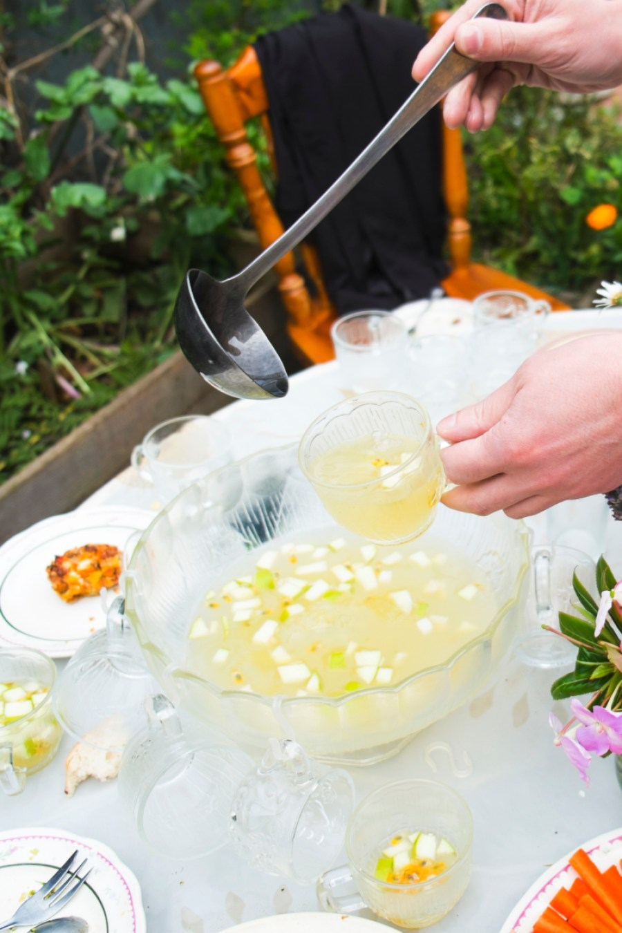 Elderflower punch - cordial, sparkling mineral water, passionfruit pulp, apple slices and ice.