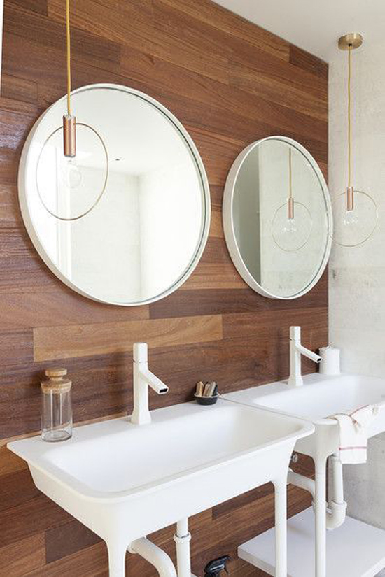 The Design Confidential Bathe Well Rounded Mirrors in the Bath Vintage with Inspired Sinks Wood Paneling Double Sink Hanging Brass Pendant Lights