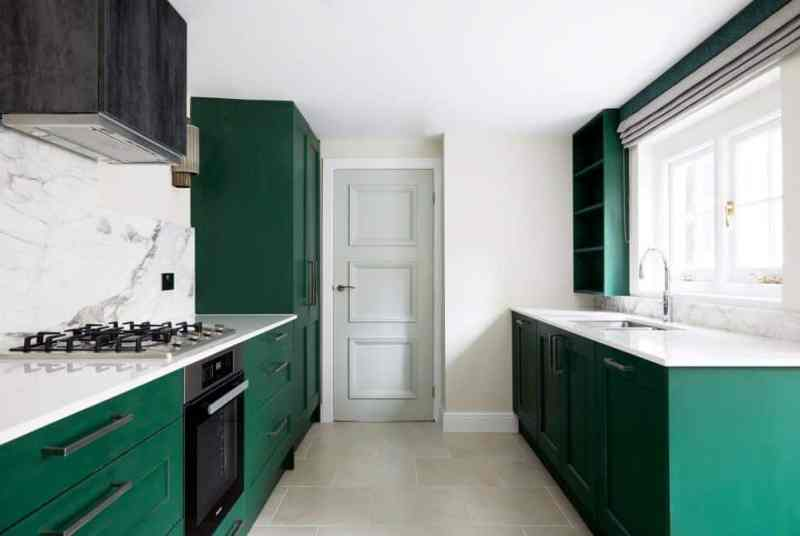 Kitchen design trends - green kitchen cabinet and marble backsplash. Design by Kia Designs