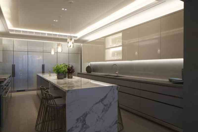 Kitchen design trends - Minimal use of ceiling recessed downlights in a kitchen. Lighting by John Cullen Lighting