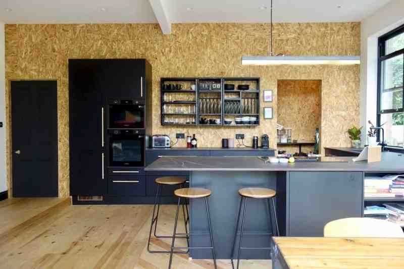 Kitchen design trends - black kitchen by Making Spaces using osb board on the walls