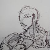 Women in metal armour - head close-up