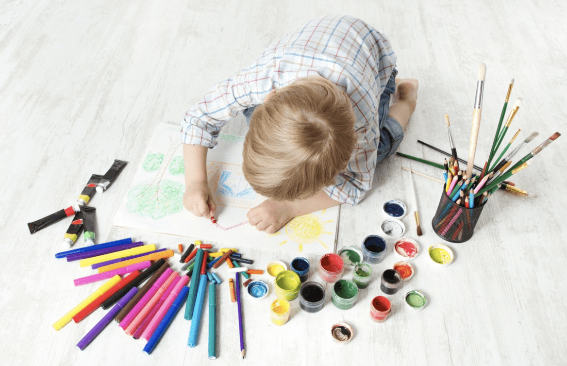 kid drawing with creativity and colour pencils