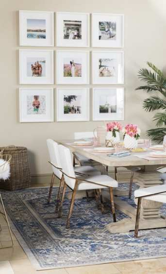 Christine Andrew's dining room with family photos and beautiful white frames | Photo Source: PopSugar Living (https://www.popsugar.com/home/Hello-Fashion-Blogger-Dining-Room-43551705)