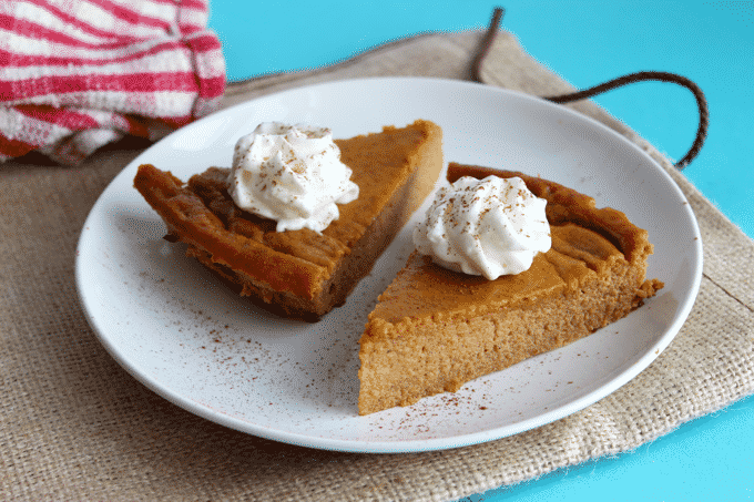 The HEALTHIEST and BEST TASTING pumpkin pie recipe ever! Only 141 Calories per slice. Plus, each serving has 11g of protein. #Healthy #pumpkinpie