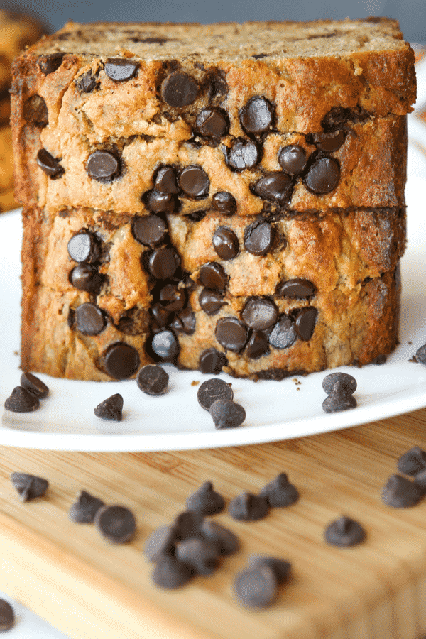 EASY HEALTHY MOIST Banana Bread! This is the BEST skinny chocolate chip banana bread recipe you'll every make. It makes for a great healthy snack, or even as a healthy breakfast idea.