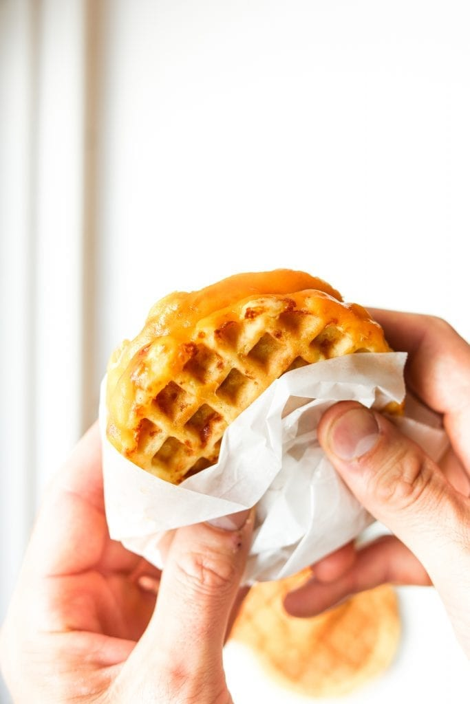 Chaffle Grilled Cheese Sandwich being held.