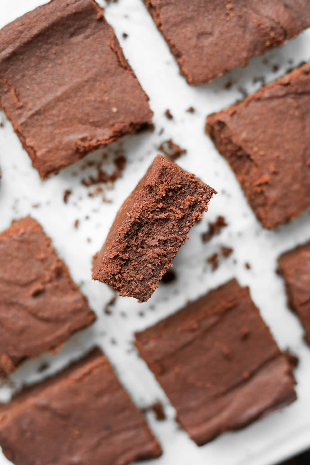Low carb brownies laying on a plate, cut up into squares