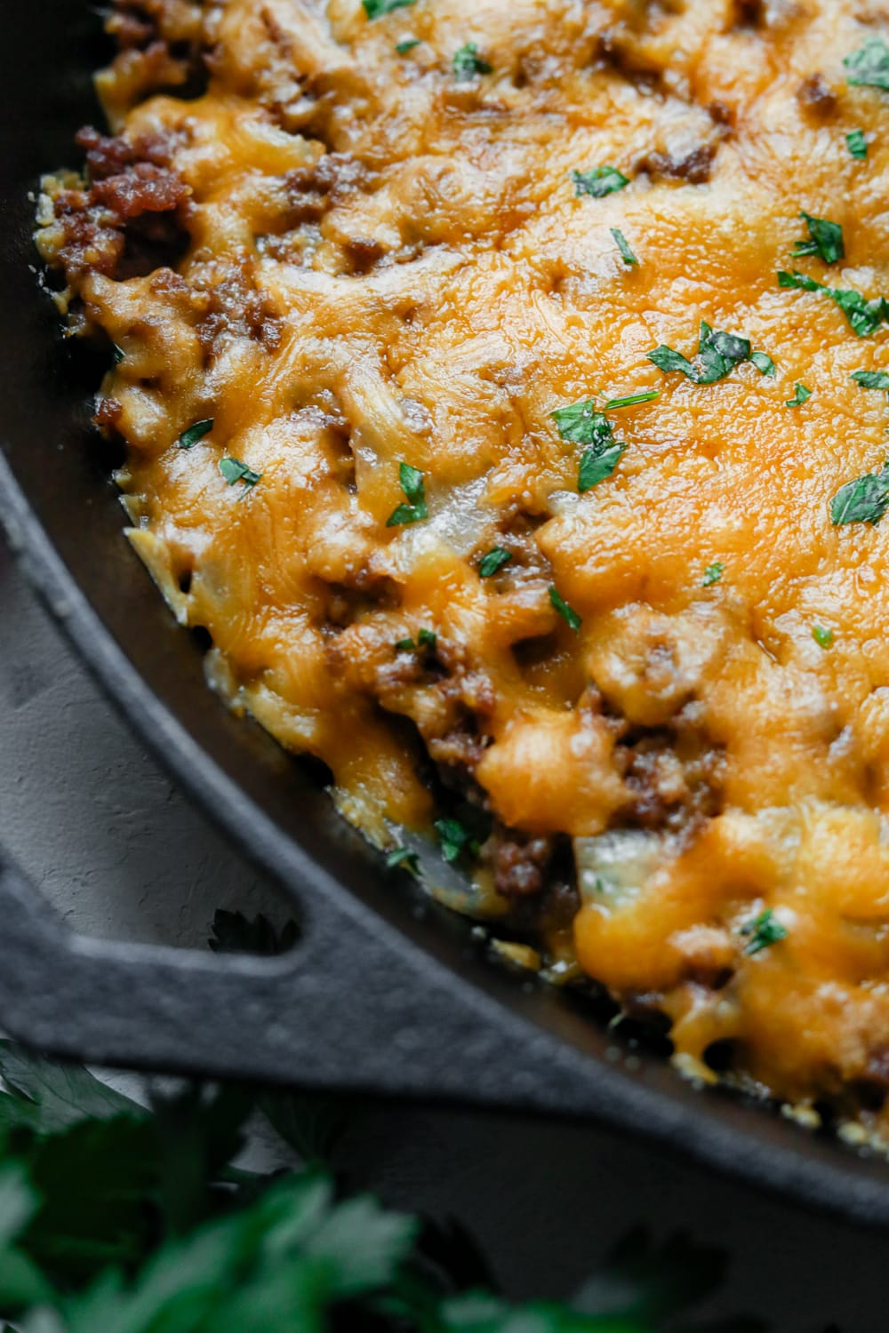 A low carb cheeseburger casserole in a cast iron pan