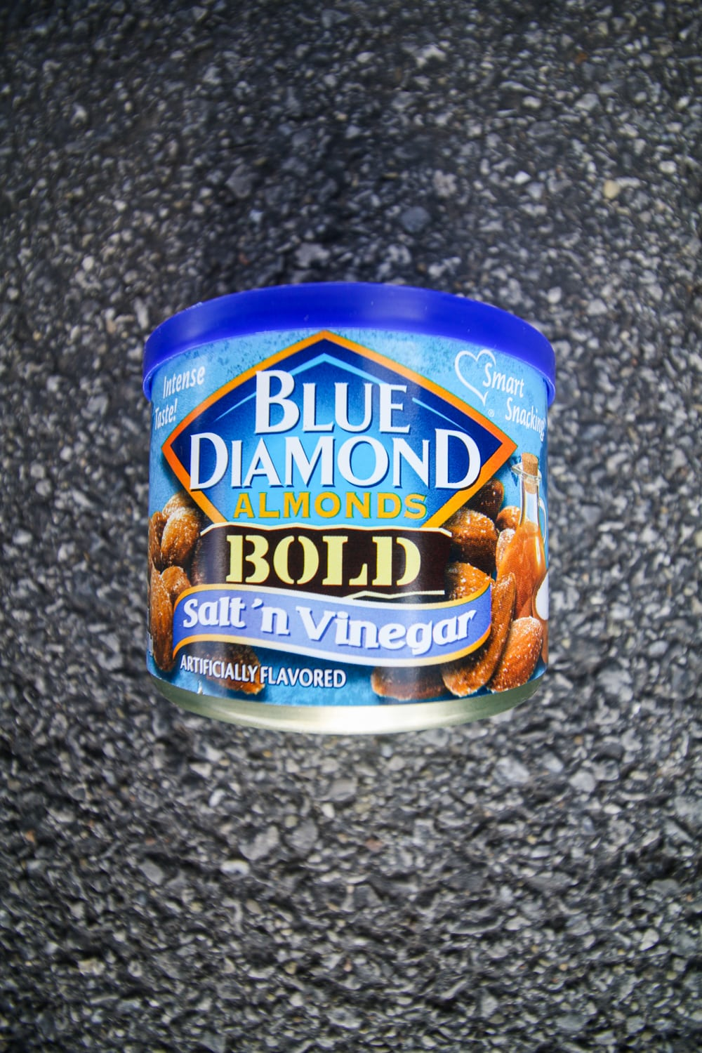 A container of salt and vinegar almonds.