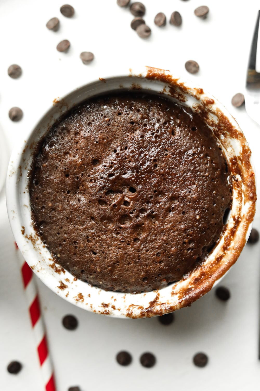 A chocolate cake in a white mug.