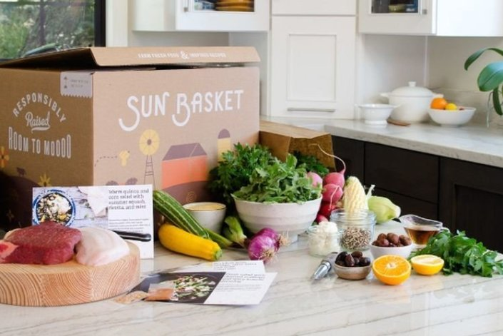 a shipment of sun basket food displayed on the kitchen counter
