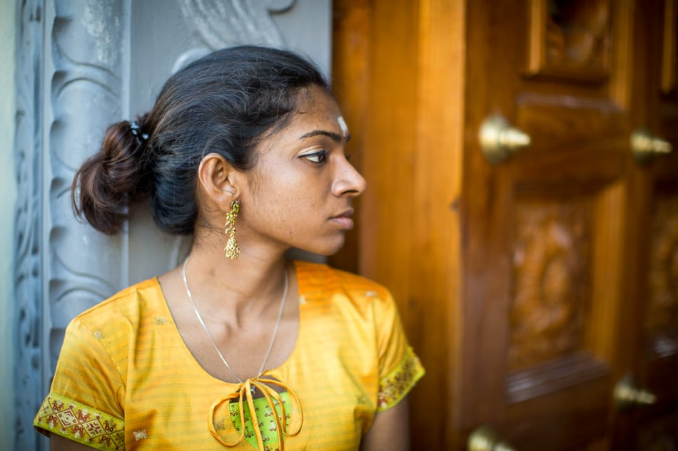 With her pilgrimage complete, this young woman relaxes at the door the temple.
