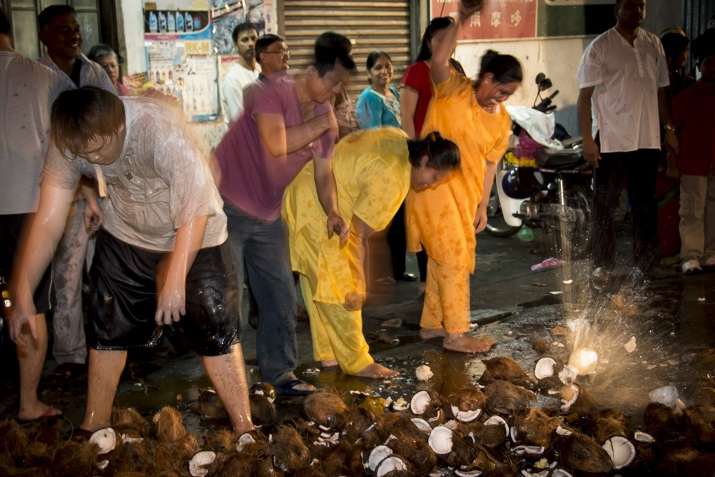 The smashing of coconuts as an act of devotion. Photographed by Scott Rust