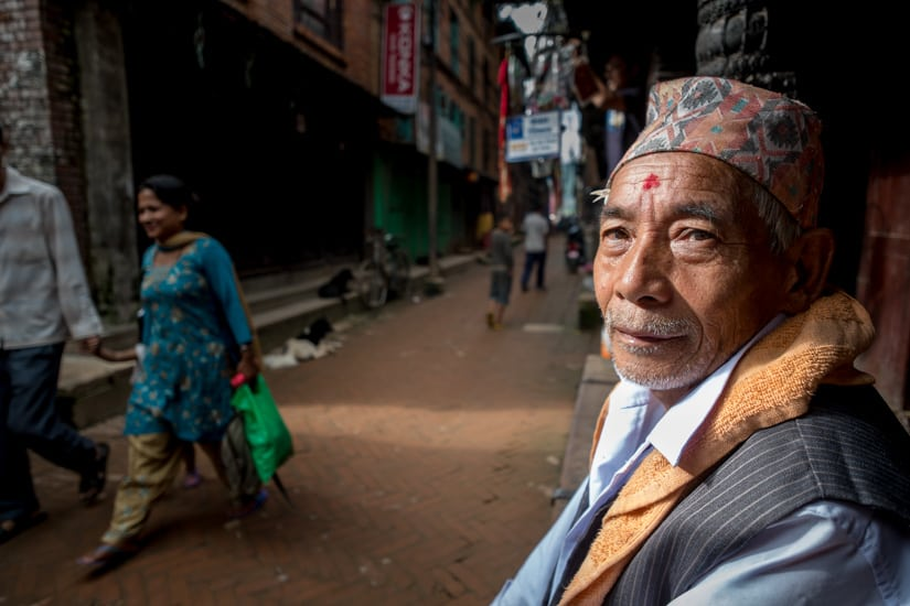 Yet another man sitting on a roadside porch in Bhaktapur, Nepal.f/2.8, 1/220 sec, at 14mm, 200 ISO, on a X-Pro1